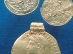 Fig. 4. Zagorzyn, obverse of a Constantius II medallion struck at Rome in 356, two Scandinavian bracteats type B and C (Landesmuseum Stuttgart).